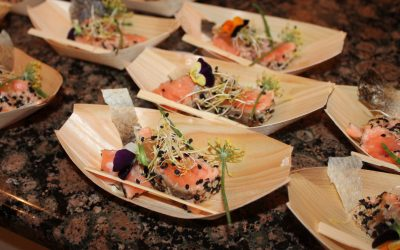 Seared Salmon Sashimi with a Sesame Seed Crust, Passion Fruit, Onion Sprouts and Toasted Shaved Coconut